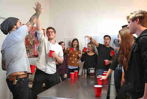 guys playing flip cup