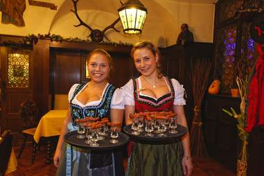 women in dirndls with beer