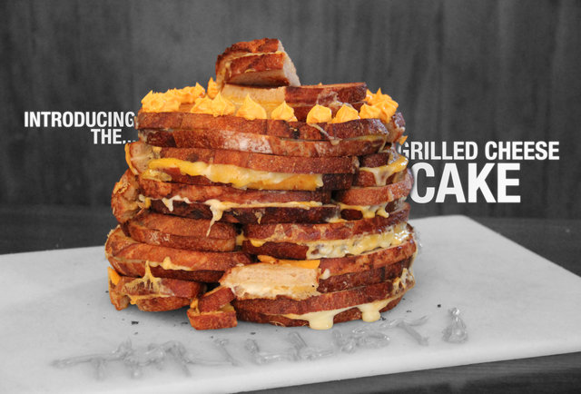 There is a cake made out of 30 grilled cheeses