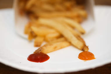 French fries with sriracha and yellowbird