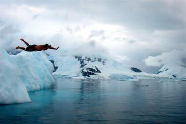 Deception Island, guy jumping in glacier water