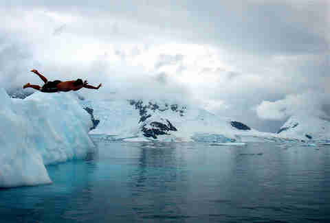 Deception Island, guy jumping in glacier water
