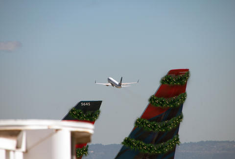 Holiday dressed airplanes taking off