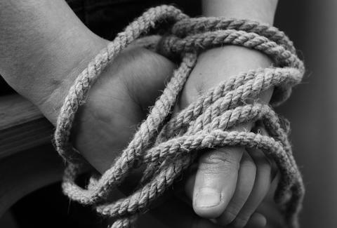 hands bound in rope