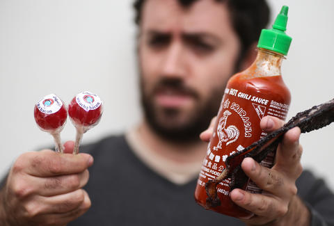 holding sriracha and lollypop