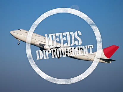 "airplane with ""needs improvement"" stamp"