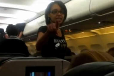 Woman arrested on plane