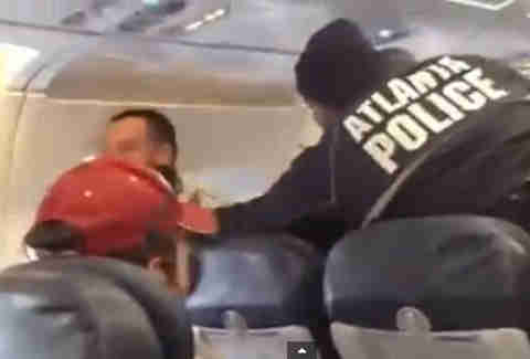 Dude being detained on flight