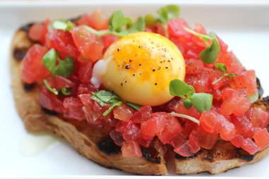 tomato and egg yolk bruschetta broders terzo vino bar minneapolis