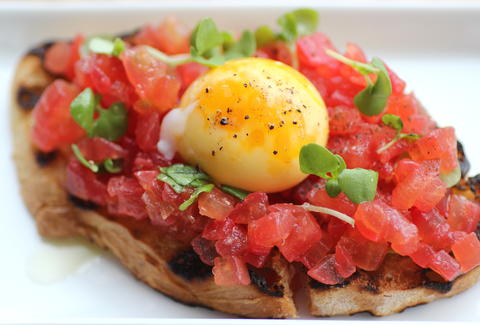 tomato and egg yolk bruschetta broders terzo vino bar minneapolis