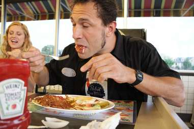 Guy eating Waffle House food