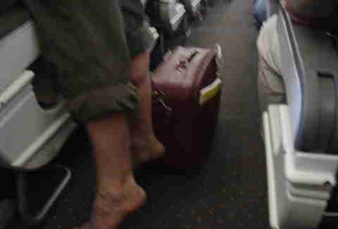 Dude on plane without shoes