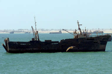 rusted ship listing to the side