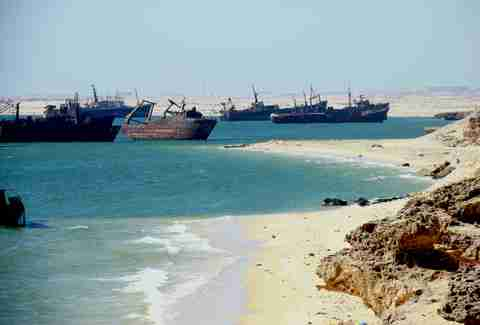 rusted ships on the shore