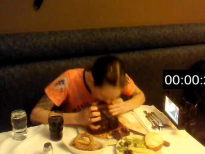 woman eating 72oz steak