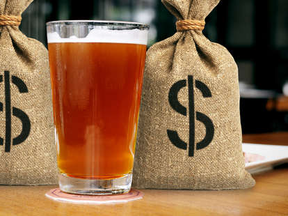 Pint of beer with money bags