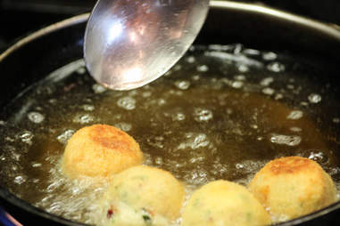 frying mashed potato balls