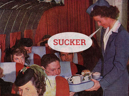 retro airline stewardess serving a meal to suckers