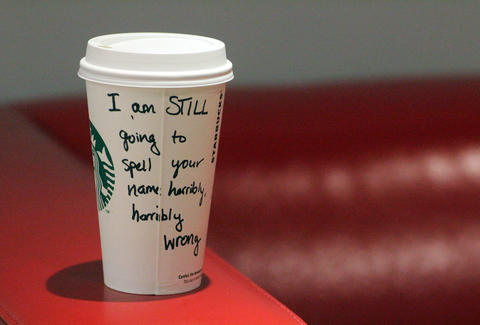 Misspelled Starbucks coffee cup
