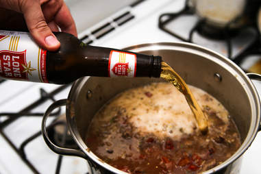pouring beer in chili