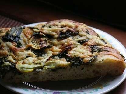 close up of pizza at arizmendi bakery san francisco