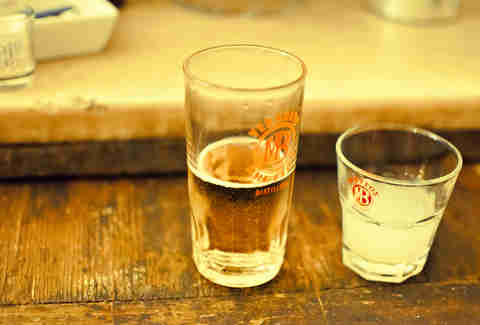 Ouzo poured into two shot glasses