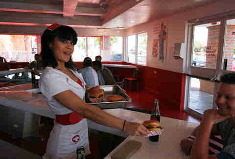 Waitress with burger at Heart Attack Grill
