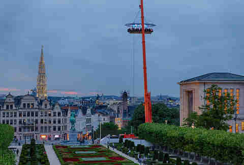 Dinner in the sky, a table suspended in the air by a crane