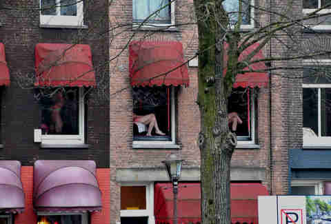 Legs in Amsterdam Red Light District windows