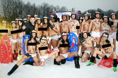 Topless sledding team