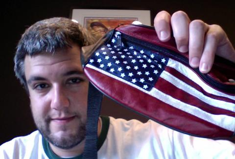 Fanny pack with US flag print held by proud owner