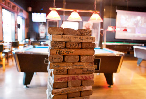 Bars with bar games - Thrillist Portland