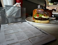 Menu and burger  at The Custom Burger Aventura