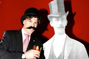 Guy posing with Count Negroni cutout