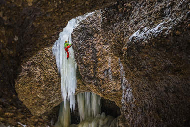 Icicles over rocks
