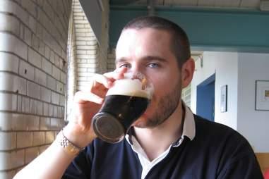 man drinking guinness