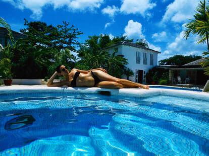Woman lying by swimming pool