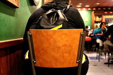 Girl with Livestrong Backpack at Moe's Tavern at Universal Studios Orlando