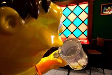 Barney Gumble statue at Moe's Tavern at Universal Studios Orlando