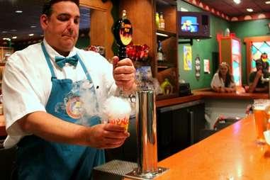Bartender pouring Flaming Moe at Moe's Tavern at Universal Studios Orlando