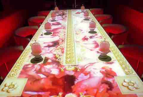 Sublimotion table with projected art