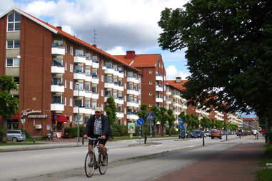 man biking down street