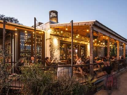 The Hay Merchant 12 Essential Restaurants HOU underbelly outdoor porch with string lights thrillist