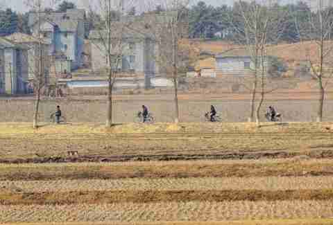 north korean countryside cyclists