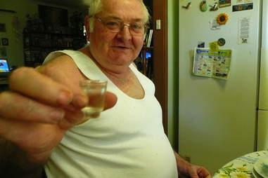 dad doing shot of vodka