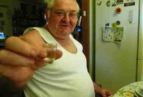 dad doing shot of vodka