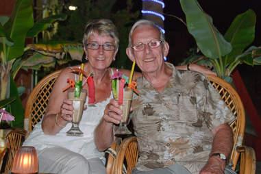 dad drinking tiki cocktail