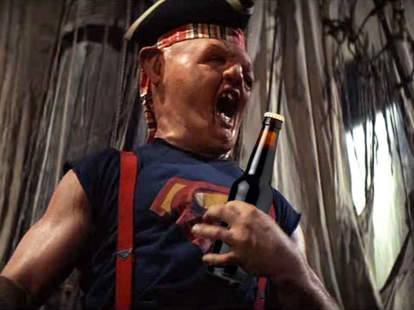 Sloth from The Goonies holding a beer bottle