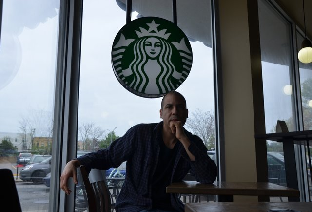 This guy\'s drinking a cup of coffee at every Starbucks in the world