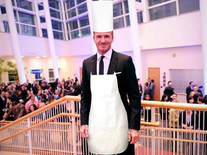 David Beckham in chef's toque and apron